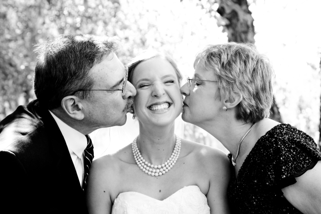parents cheek kiss wedding